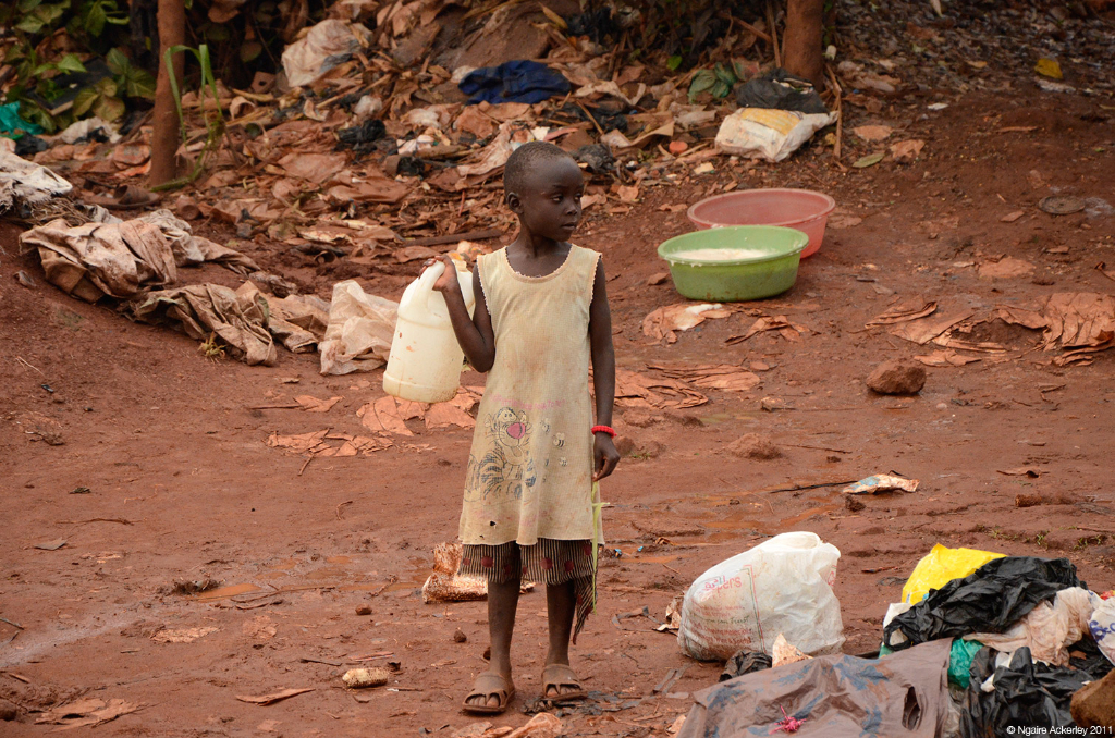 Child on roadside near Kampala, Uganda.